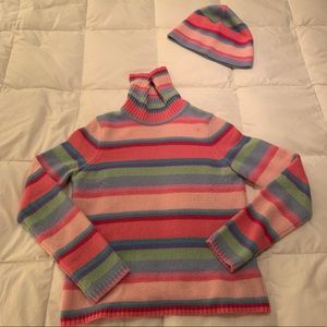 STRIPED LAMBSWOOL SWEATER AND HAT.